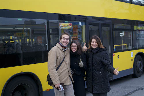 Posing in front of the bus