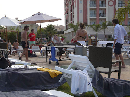 Delegates playing ping-pong by the pool