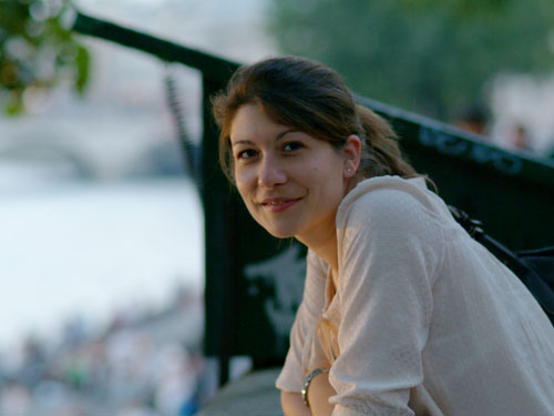 Aude peers out onto the Seine at dusk