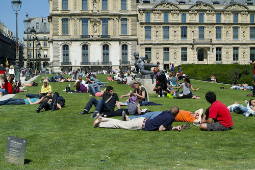 Sunbathers on the lawn in front of the Louvre