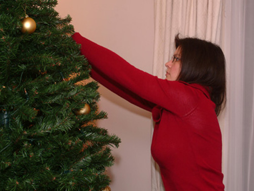 Anne Laure, hard at work decorating the tree