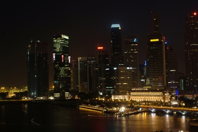 The view from the hotel room over the Singapore harbour at nightfall