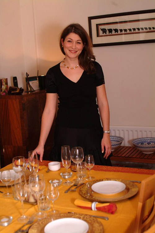 Aude poses in front of the Christmas table